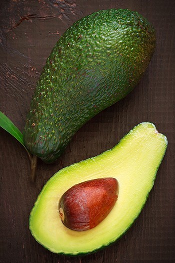 ripe avocado sliced in half